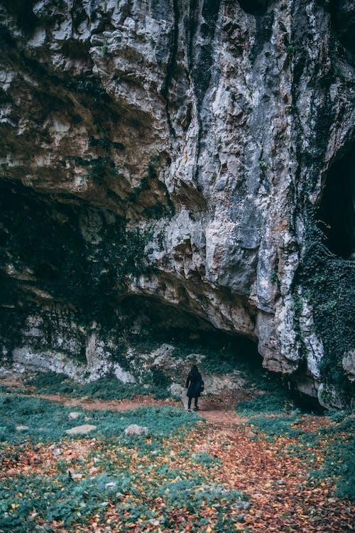 Woman Wearing Black Coat Standing Near Gray Mountain