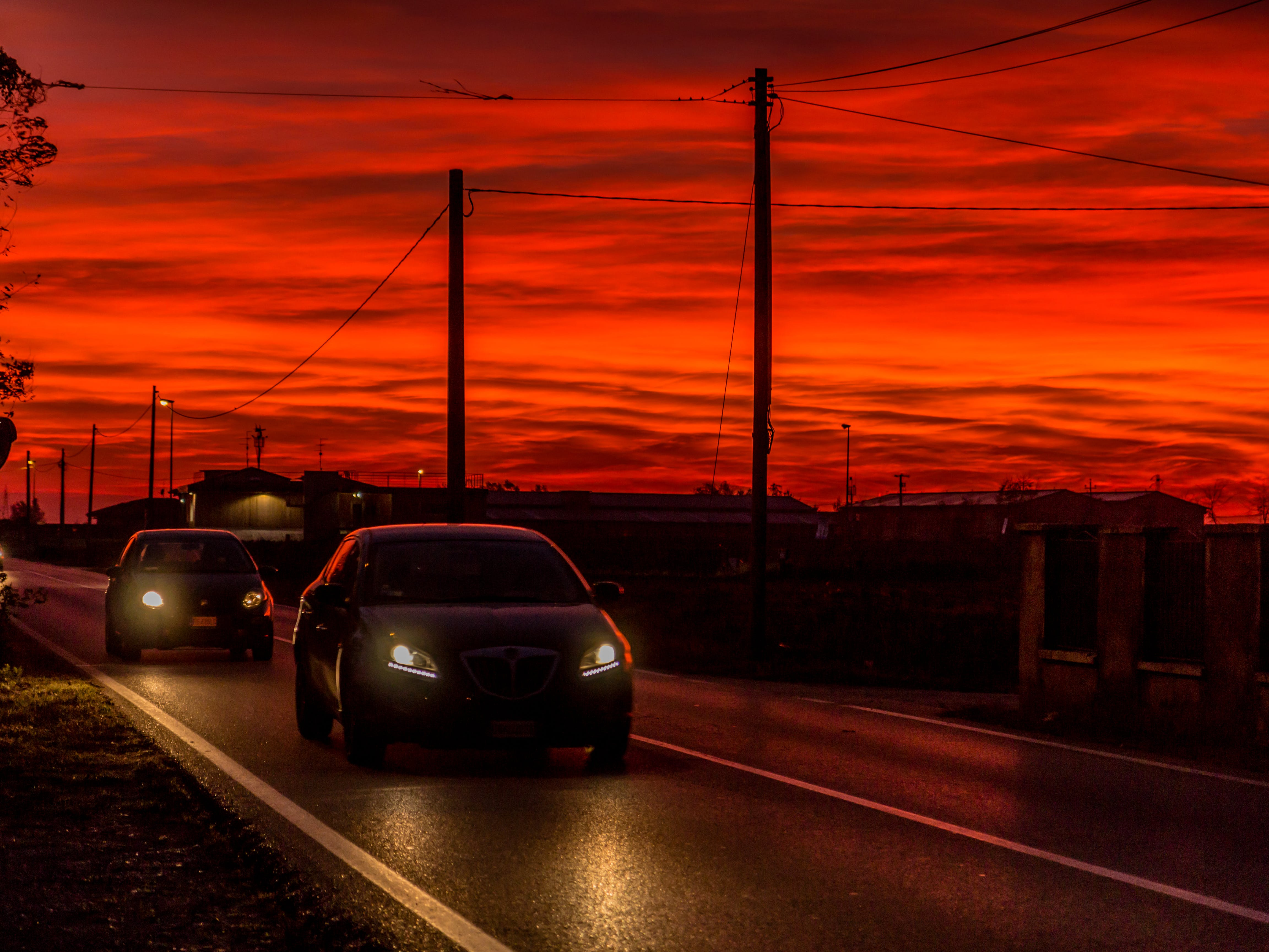 Two Cars On Road During Golden Hour