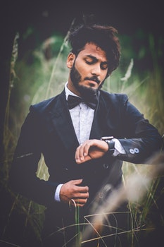 Man in Tuxedo Suit Surrounded by Grass