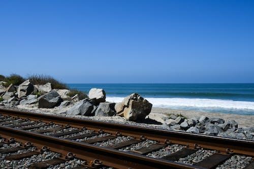 Free stock photo of coastal and oceanic landforms, railroad track