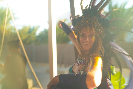 Woman Wearing Blue Spaghetti-strap Top With Feather Headdress
