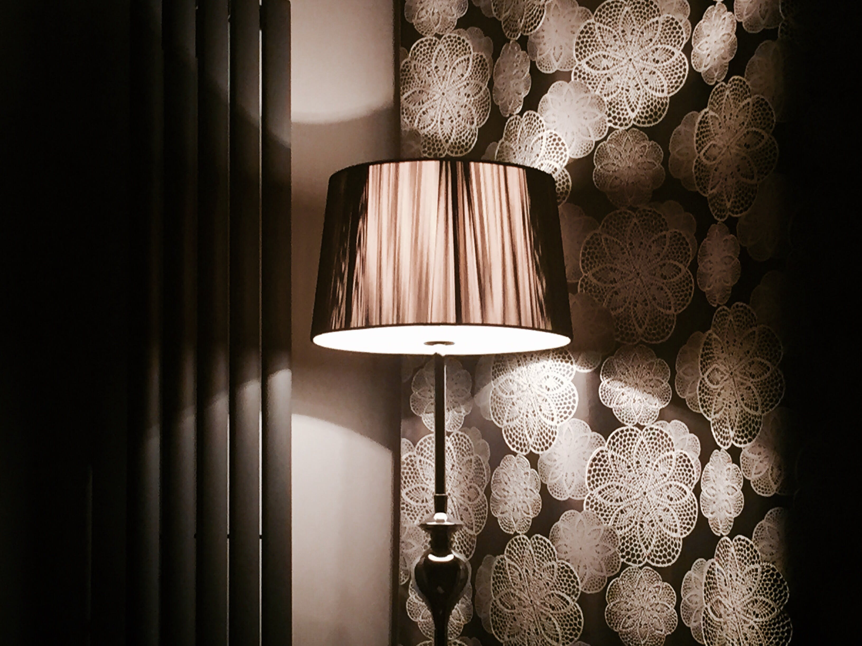 Lighted Brown and White Lamp Near Floral Wall