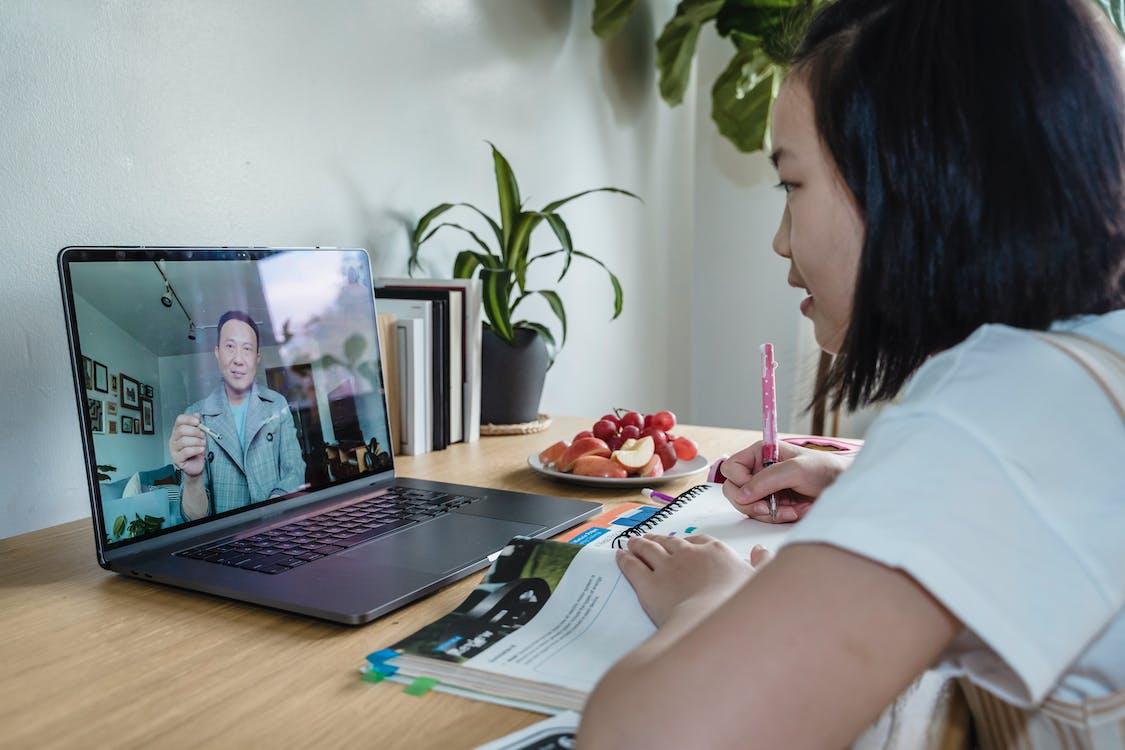 A Girl Attending an Online Class