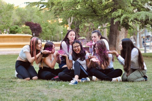 Group of Young Women Sitting on the Grass