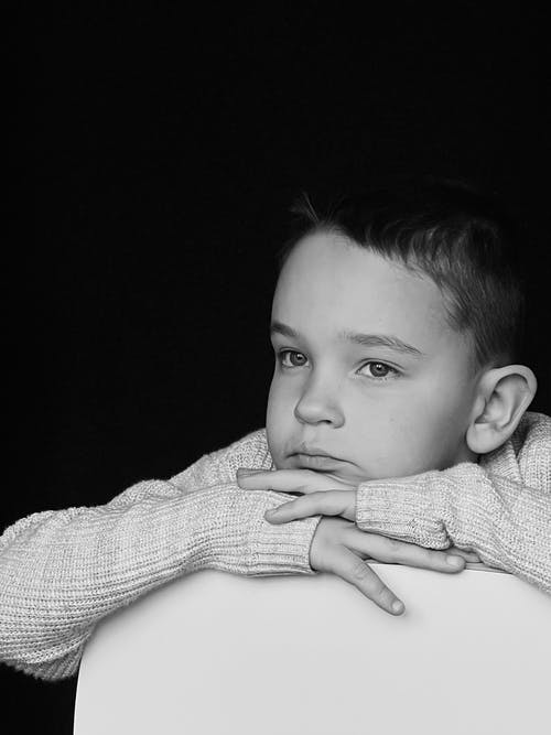 Grayscale Photo of Boy in Sweater