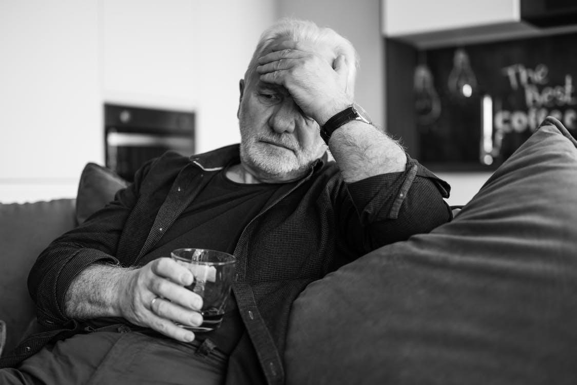 Man in Black Long Sleeve Shirt Holding Drinking Glass