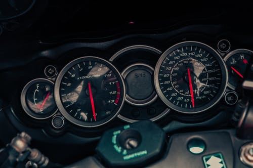 Black and Green Car Speedometer