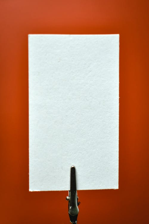 White Piece of Paper on a Red Background