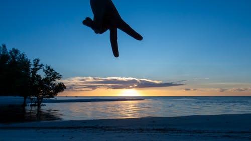 Free stock photo of beach sunset, ocean, peace sign