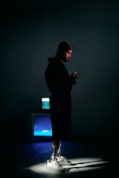 Photo of Man Busy Using Phone