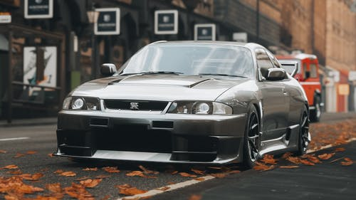Silver Bmw M 3 Coupe Parked on Sidewalk