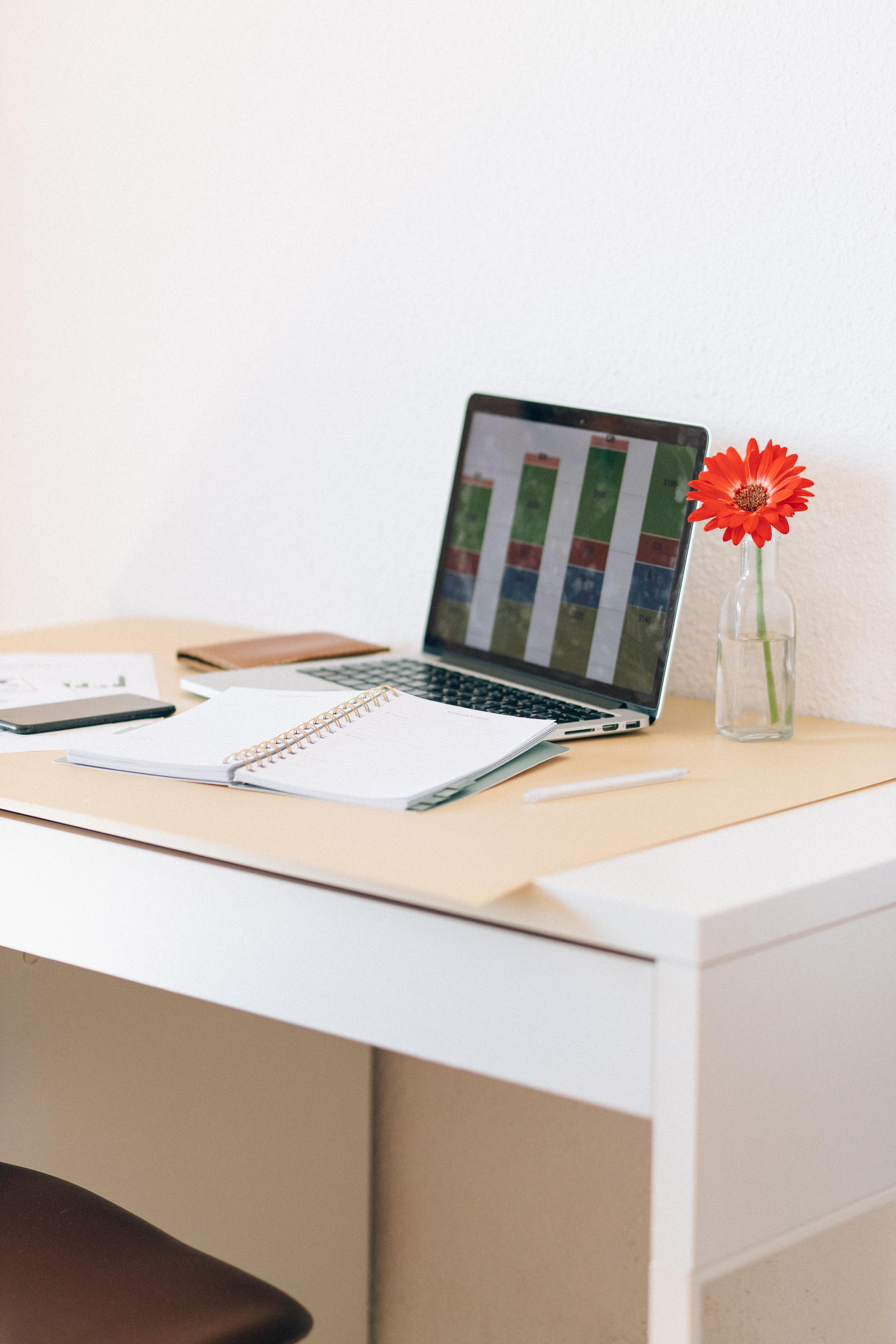 macbook pro on white wooden desk