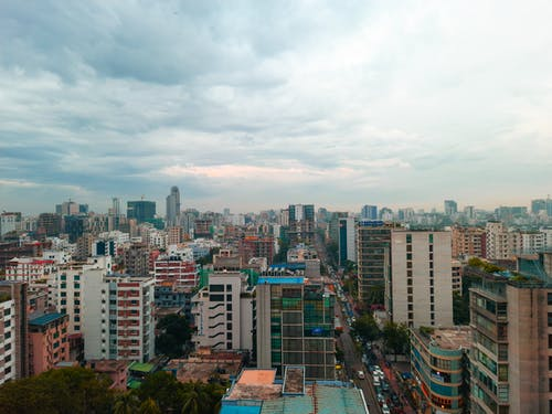 City Buildings Under White Clouds