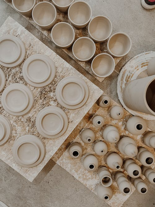 White Round Ceramic Bowls on White Ceramic Tray