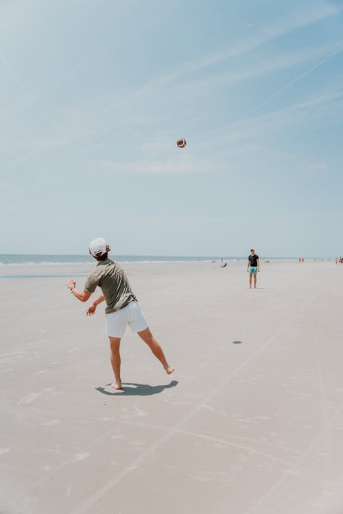 People Playing Basketball on Beach