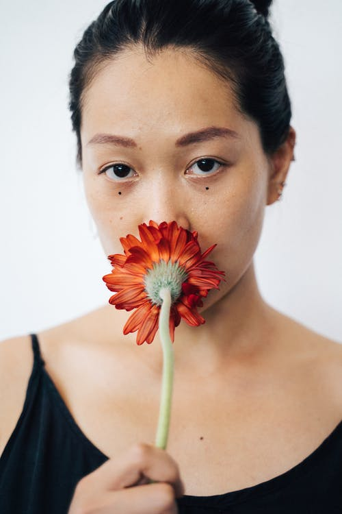 Woman Holding a Red Flower