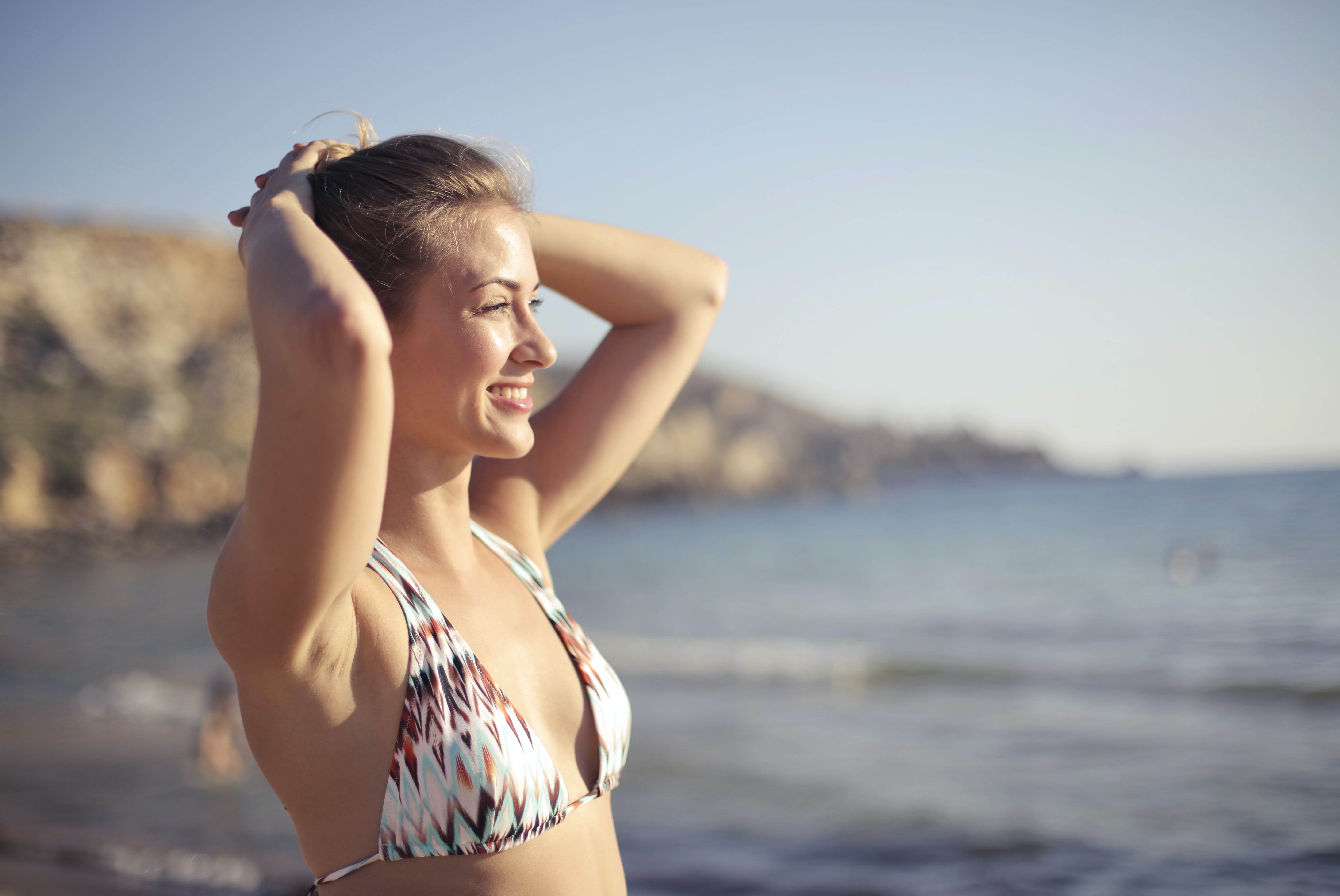 Blonde Haired Woman Wearing White 2-piece Swimsuit