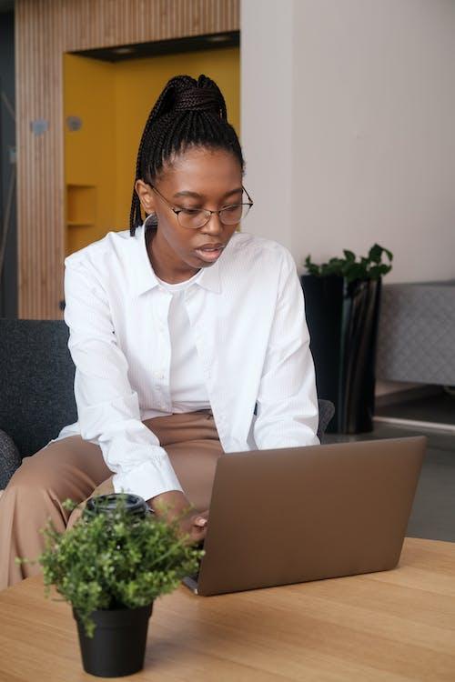 Black female employee browsing laptop