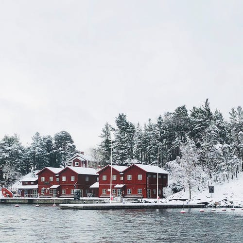 Red Concrete Houses Surrounded With Snow