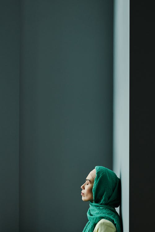 A Woman Leaning on a Wall