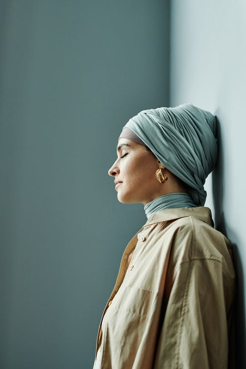 Woman in Beige Shirt and Gray Hijab