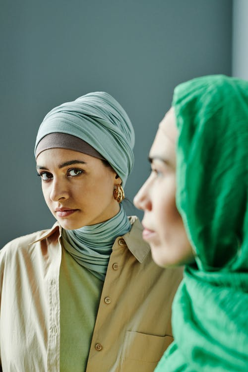 Woman in Green Hijab and White Coat