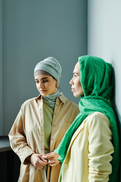 Woman in Green Hijab and Beige Coat