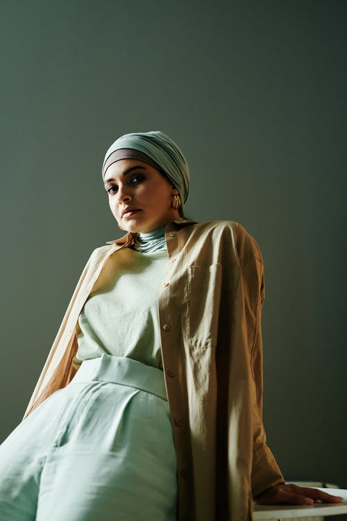 Woman in White Hijab and Brown Coat