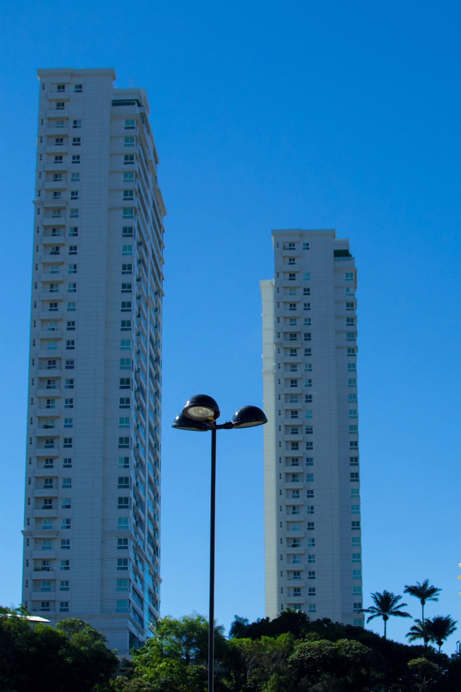 Black Light Post Near White Building