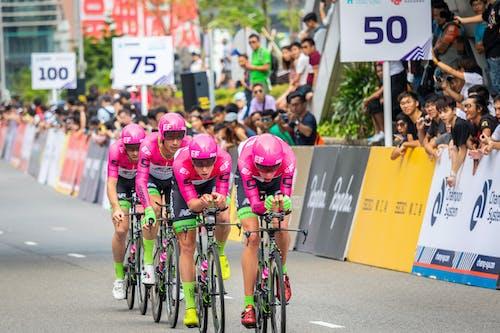 Man in Pink Shirt Riding Bicycle