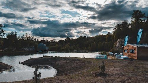 Free stock photo of abandoned building, blue lake, blue sky