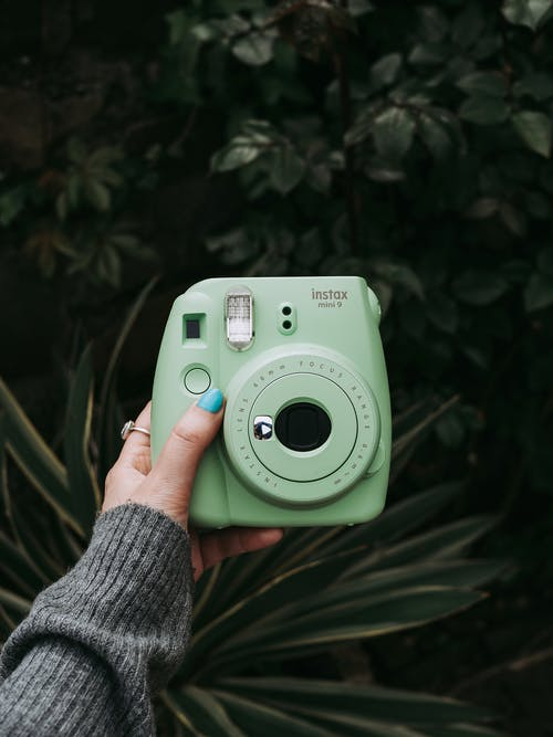 Green and White Point and Shoot Camera