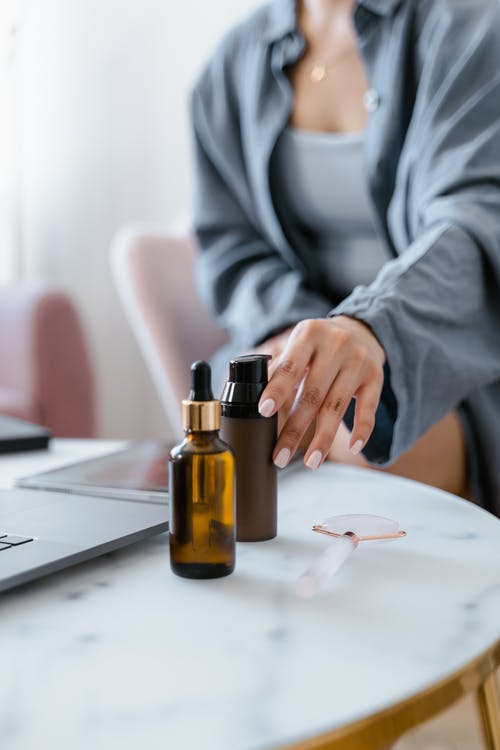 A Woman Using Essential Oil Products