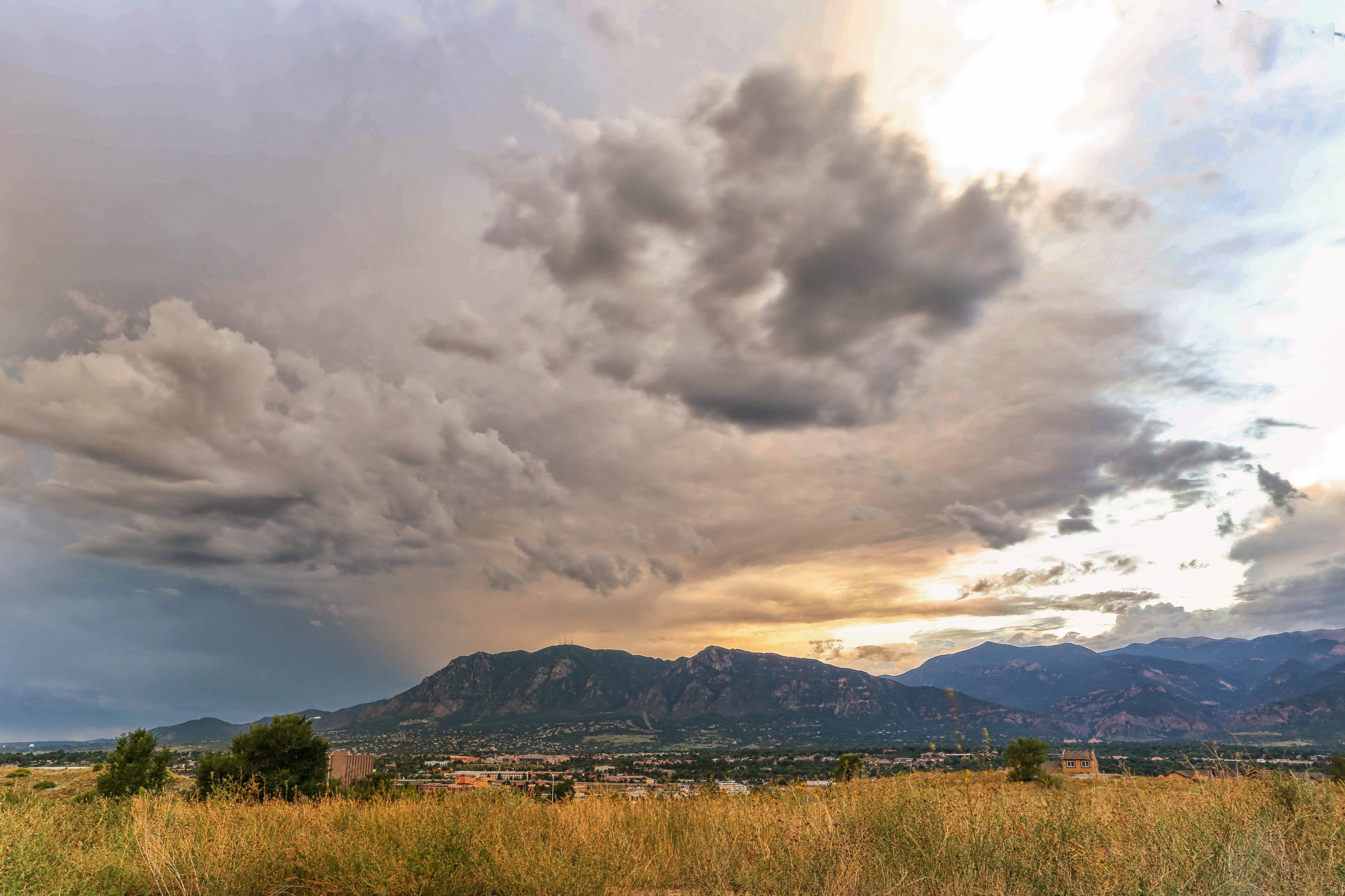 Free stock photo of cloudy sky, colorado, grass field, mountain
