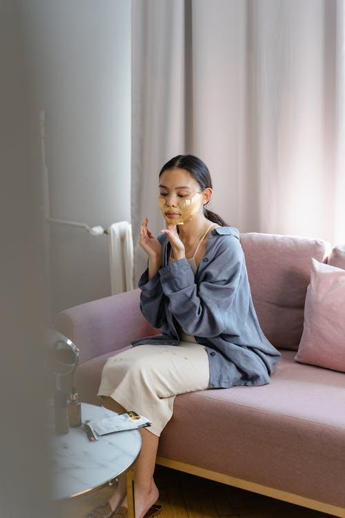 A Woman Putting a Facial Mask
