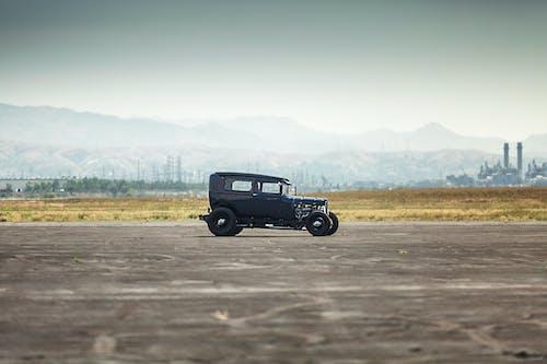 Foto d'estoc gratuïta de barra calenta, biplaça descapotable, carrer, cotxe antic
