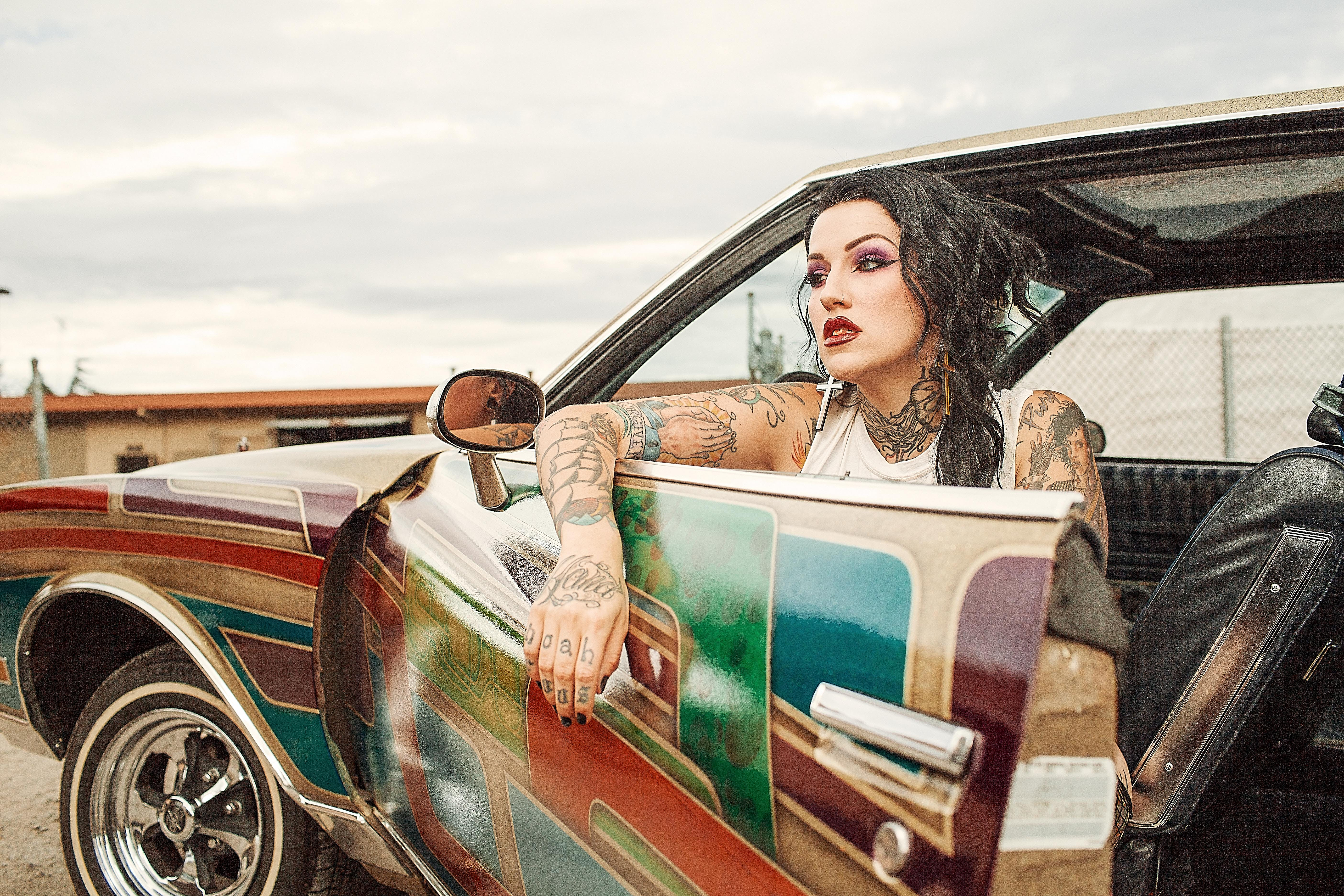 Woman With White Tank Top Inside Classic Multicolored Car