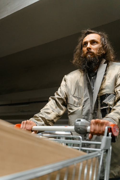 Bearded Man Holding a Shopping Cart
