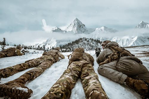 Soldiers in Prone Position on the Snow Covered Ground
