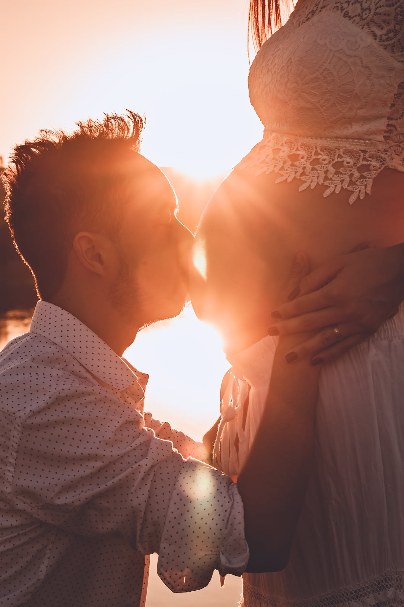 Man Kissing Woman's Belly
