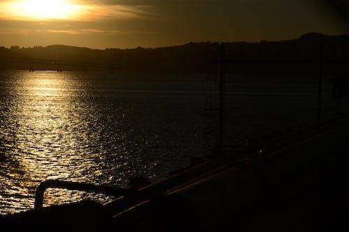 Foto profissional grátis de mar, pôr do sol