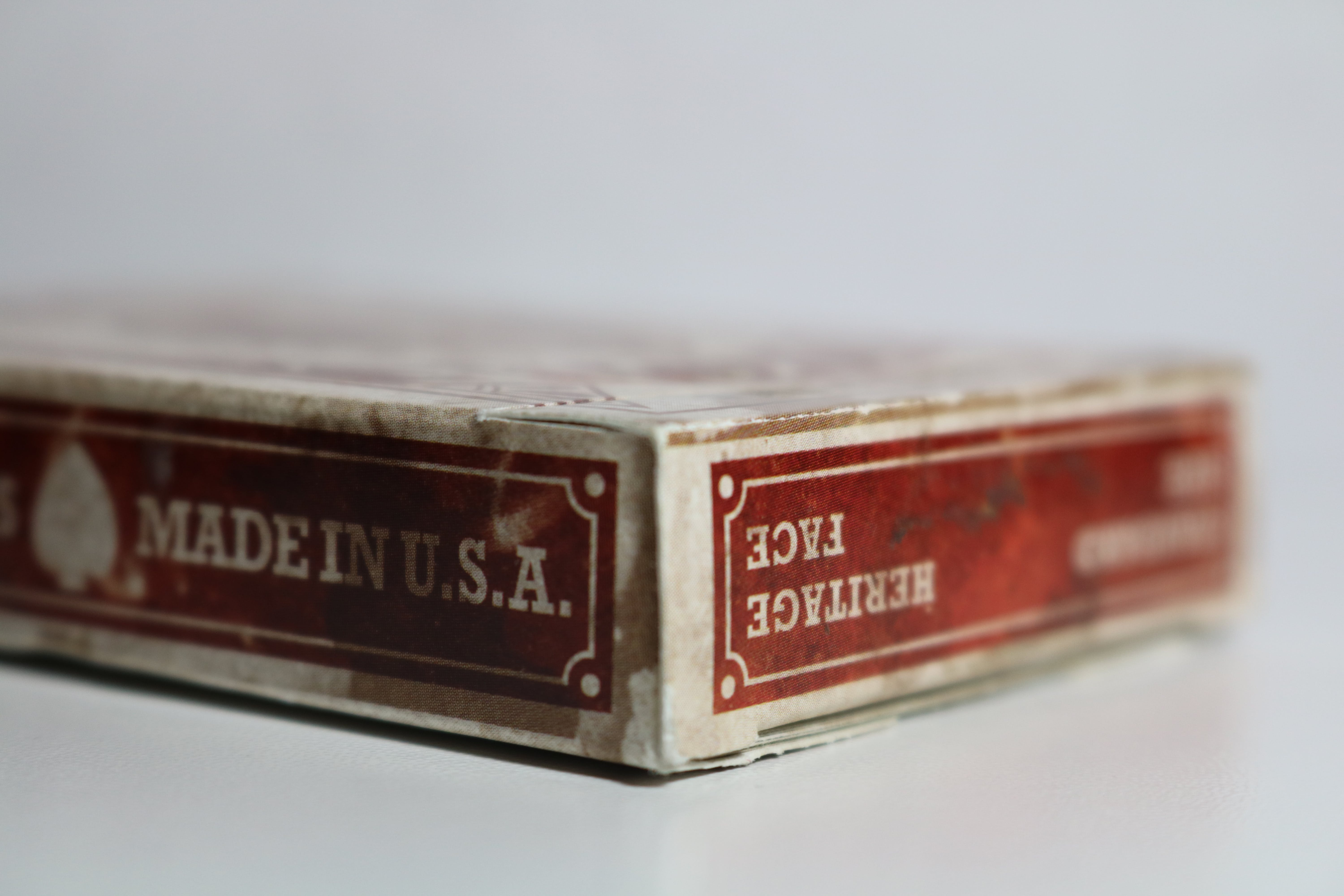 Close-Up Photography of Dirty Playing Card Box
