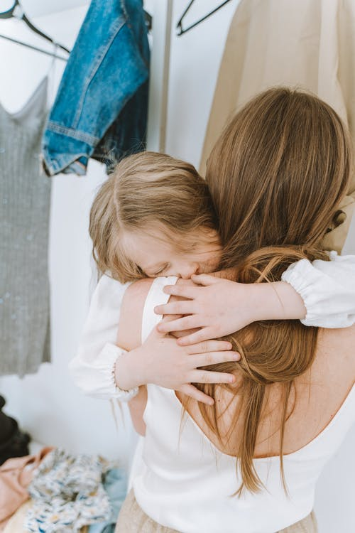 Child  Asleep on Woman's Shoulder