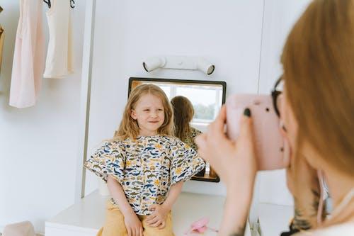 Girl Smiling at a Camera