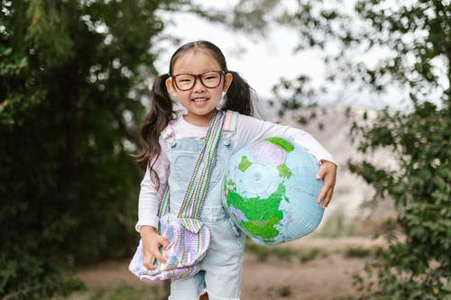 Smiling Girl Holding an Inflatable Globe