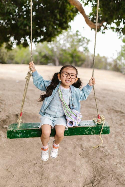 Girl Swinging Happily
