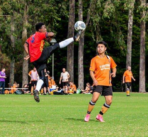 Football Player Kicks the Ball