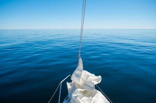 Sailing on a Calm Sea Water with a Sailboat