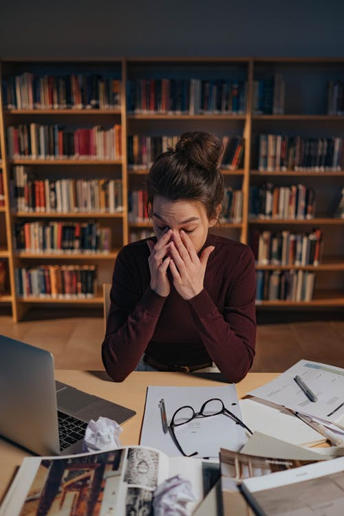Tired Woman in the Library