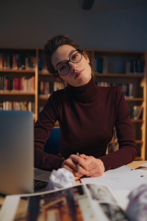 Woman in Long Sleeve Shirt Wearing Black Framed Eyeglasses